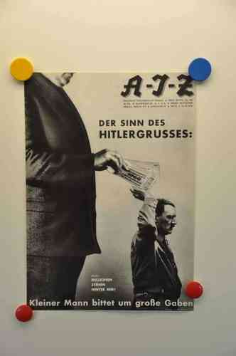 Photomontage The Meaning of Hitler greeting Heartfield