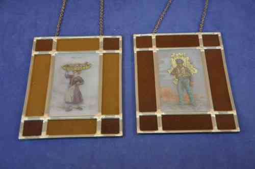 Old market images on 2 stained glass images on chains