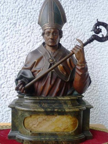 Wood sculpture Bishop on marbled pedestal around 1850