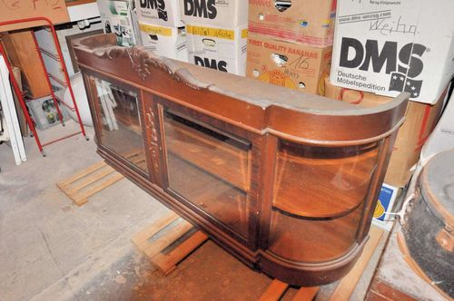 Top of a buffet cabinet with round glass panes 1920