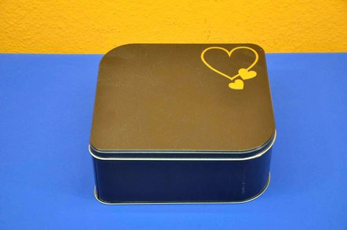 Large tin cans with heart cookie jar