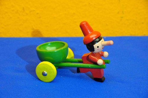Pinocchio wooden figure with trolley egg cup