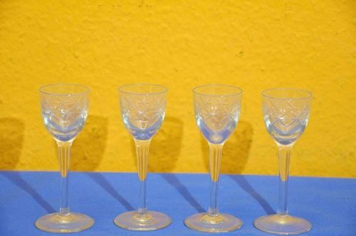 4 antique liqueur glasses with cut stars